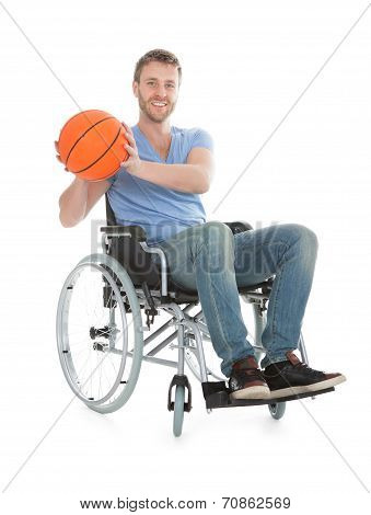 Disabled Player Holding Basketball On Wheelchair