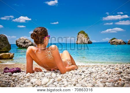 Beautiful woman on Piso Kryoneri beach in Parga, Greece.