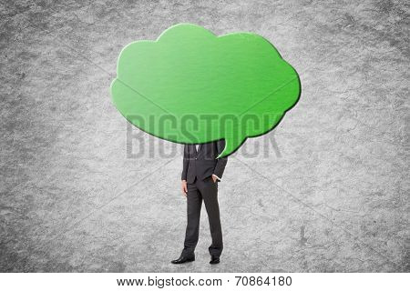 Young businessman with head behind the clouds.