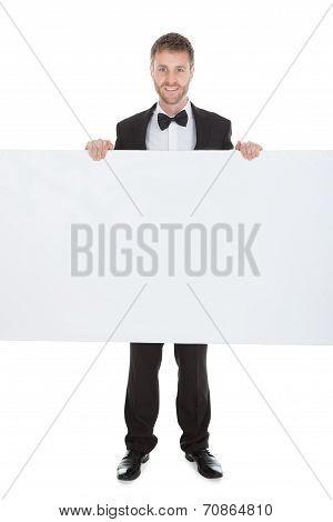 Butler Looking At Blank Billboard