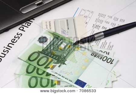 Business Plan With Euro Notes, Check Book And A Pen