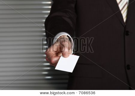 A Business Man's Hand With A Card