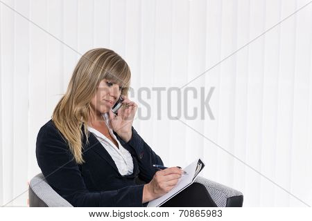 Woman Is Phoning And Making Notes