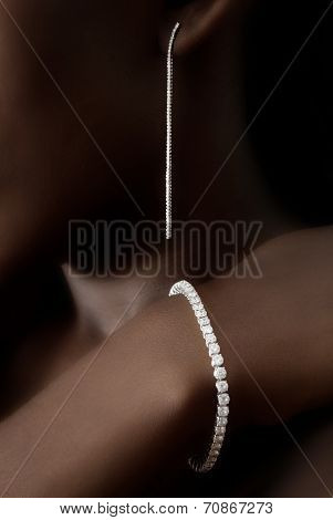 Diamonds Earring and Bracelet on Black Skin, Designer Jewellery