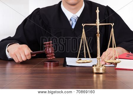 Judge With Mallet And Weight Scale In Courtroom