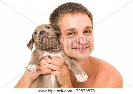 Man with a puppy pitbull