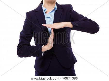 Businesswoman with pause hand gesture