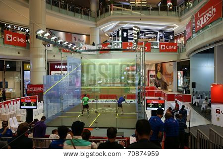 AUGUST 21, 2014 - KUALA LUMPUR, MALAYSIA: Borja Golan of Spain (green shirt) plays Olli Tuominen of Finland in a match at the CIMB Malaysian Open Squash Championship 2014 held in Nu Sentral Mall.