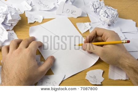 Workspace With Crushed Paper And Hands