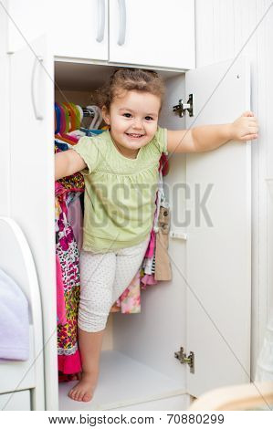 Little Girl Hiding Inside Wardrobe
