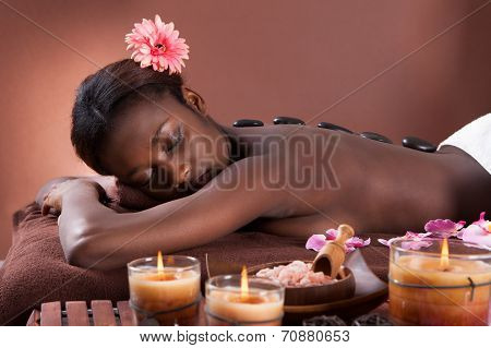 Woman Undergoing Lastone Therapy At Spa