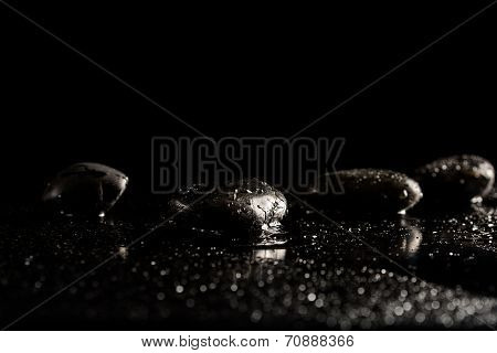 Spa Background With Wet Basalt Massage Stones