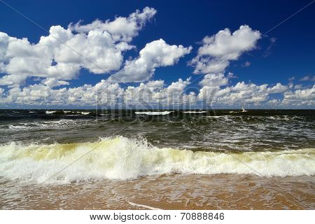 Surf And Cumulus Clouds
