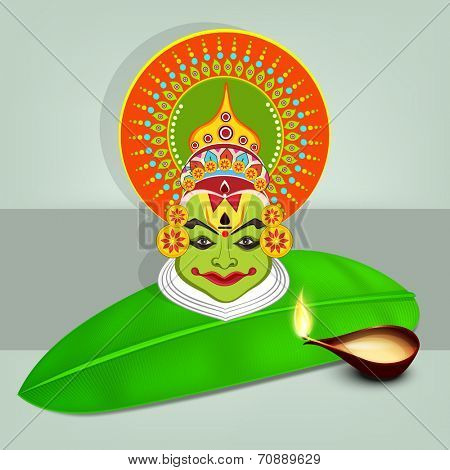 Image of kathakali dancer face with heavy makeup on banana leaf and illuminated oil lit lamp on gray and light gray background.