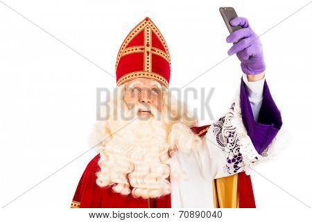 Sinterklaas  making selfie with mobile. isolated on white background. Dutch character of Santa Claus