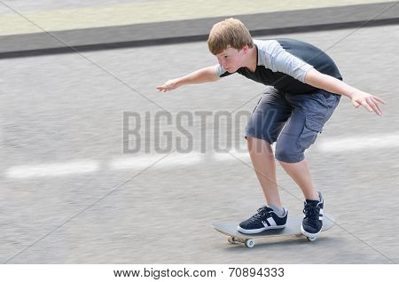 Young Skater Teenager Guy In Motion Moving On Skateboard