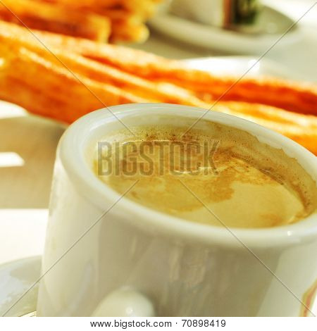 cafe y porras, coffee and thick churros, the typical breakfast in Madrid, Spain