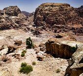 stock photo of petra jordan  - Beautiful red rock formations in Petra Jordan - JPG