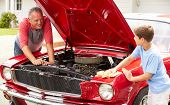 foto of grandfather  - Grandfather And Grandson Working On Restored Classic Car - JPG