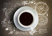 stock photo of spinner  - Close up of cup of coffee and cogwheels at background - JPG