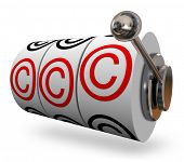 foto of won  - Copyright symbols or letter C on three slot machine wheels illustrating you won legal protection for your intellectual property - JPG