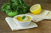 foto of pita  - traditional hummus dip of chickpea with pita bread on a wooden table - JPG