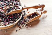 stock photo of peppercorns  - black white and red peppercorns on wooden table - JPG