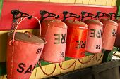 picture of fire-station  - Old style red fire buckets on a train station. ** Note: Shallow depth of field - JPG
