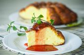 stock photo of curd  - sweet curd pudding with fruit jam on a plate - JPG