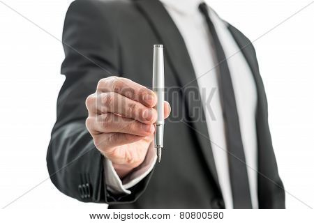 Man Holding A Fountain Pen In His Hand With The Nib Facing Down