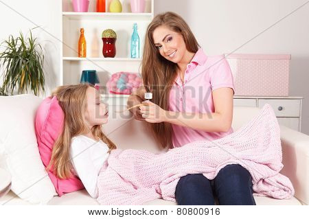 Woman Giving Medicine To Child