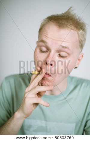 portrait of a real young smoker