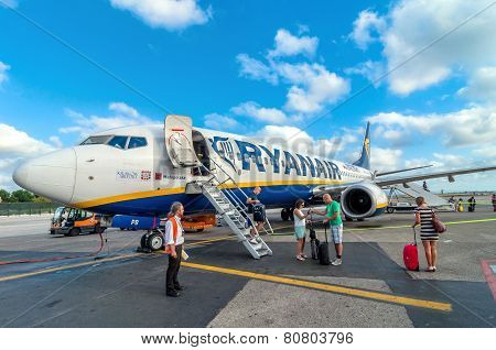 Passengers Deplane Ryanair Jet Airplane After Landing In Pisa Airport, Italy