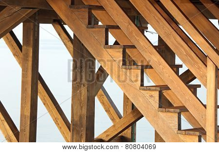 Complicated Wooden Staircase To Climb Above A Wooden Stilt House Over The Sea