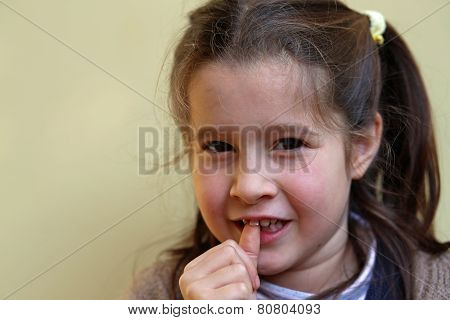 Little Girl With The Front Tooth Dangles