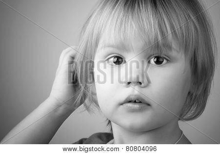 Closeup Monochrome Portrait Of Cute Blond Baby Girl