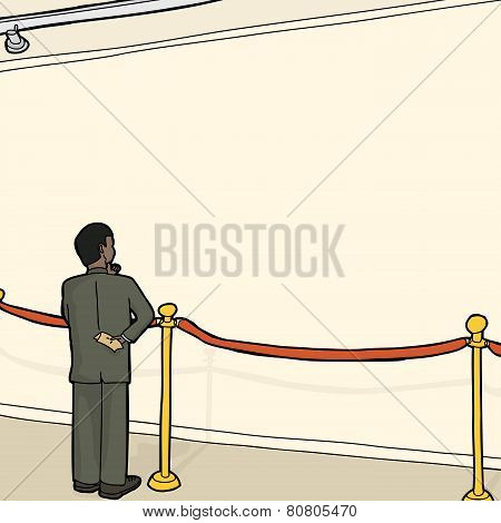 Man At Blank Wall And Stanchion