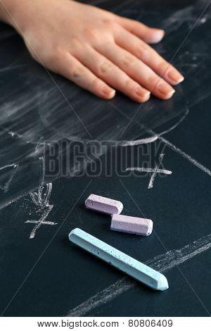Hand erased scheme football game from blackboard background