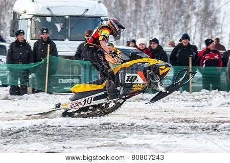 Race of sportsman on snowmobile
