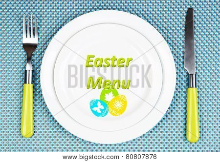 Plate with text Easter Menu, fork and knife on tablecloth background