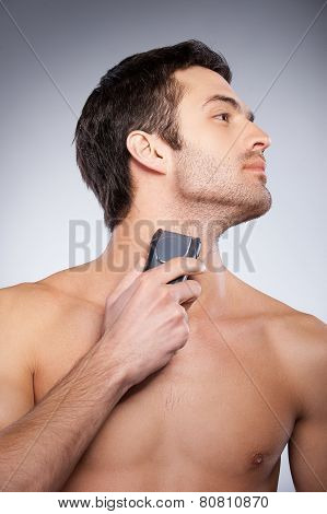 Shaving With Electric Shaver.