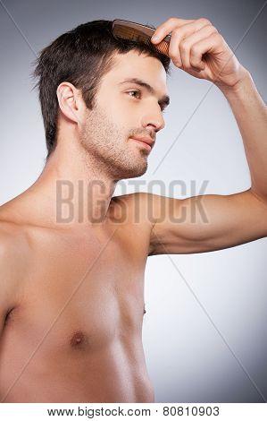 Man Combing Hair.