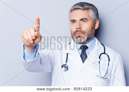 Doctor Working On Transparent Wipe Board.