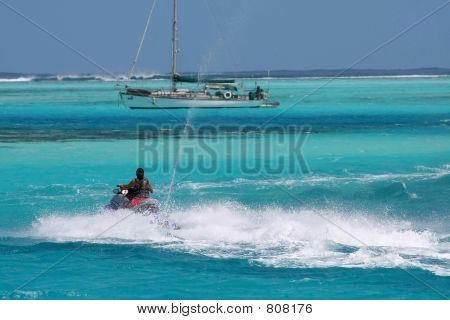 jetski passing a sailboat
