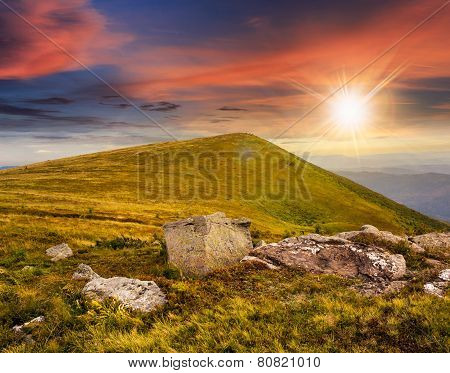 White Boulders On The Hillside At Sunset