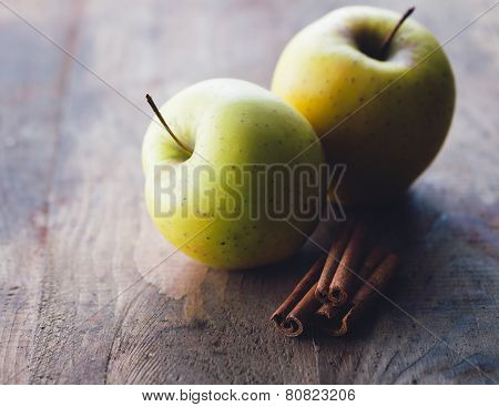 Apples and cinnamon sticks
