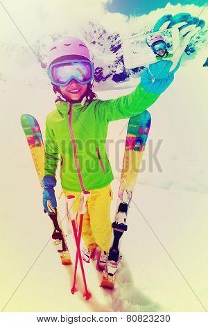 Ski, winter sport - lovely skier girl enjoying ski vacation, filtered