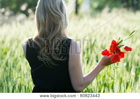 Woman collecting flowers outdoor
