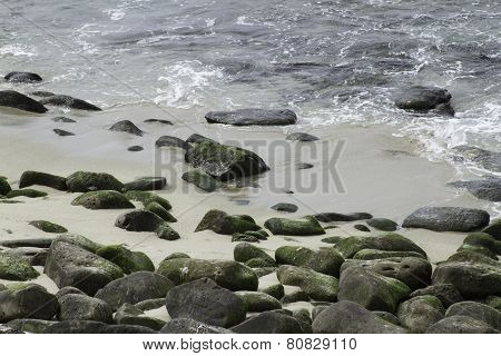 Sea Water Breaking On Rock Formations