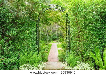 Decorative Arched Iron Gateway To A Garden